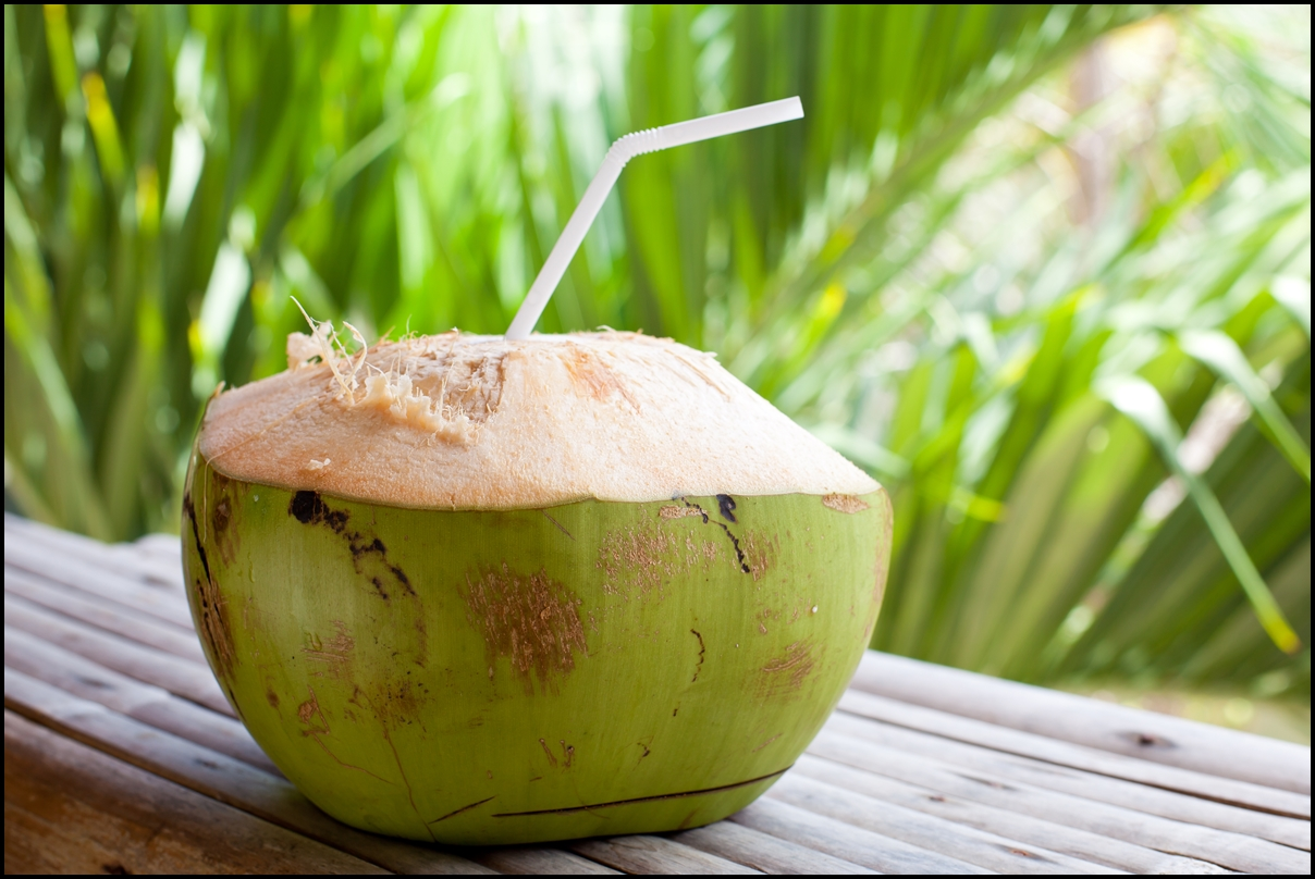 Fresh-green-coconut-on-palm-tree-background
