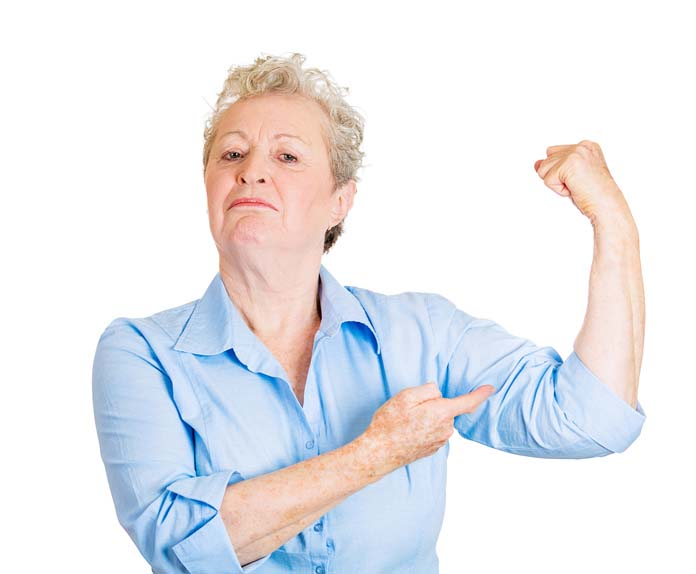 Strong woman. Senior elderly lady showing her strength